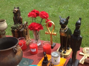 Detail of altar showing my Sekhmet and Bast statues. The Sekhmet is handmade and comes from Egypt...the Bast, well, made in China and I bought it at a Ross store!