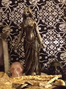Detail of the shrine to Hel that graces my living room. Hel statue made by Jeff Cullen. See his full line of amazing Pagan statuary at www.vodoustore.com.