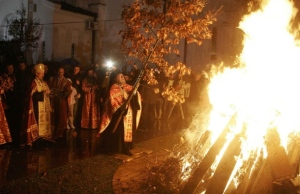 A Serbian Orthodox priest burns the previous year's badnjak, or sacred oak, on Christmas Eve (January 6) outside the steps of St. Sava Cathedral, downtown Belgrade, Serbia. Paganism never died, it just got co-opted by the Church. Oak is sacred to the old Slavic Thunder God, Perun; his nativity in January was grafted onto the Christ Child's.