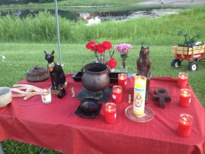 The campsite shrine I erected to Sekhmet, Bast, and Ra at this year's Pagan Spirit Gathering, held the week of Summer Solstice here in Illinois. Everyone was welcome to join me in my daily devotionals or pray in the shrine in solitude.