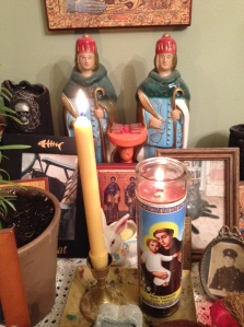 "Brazilian-made statues of Saints Cosmas and Damian are prominently featured on my ancestor altar. A Byzantine icon depicting Them as the ""Vračari"" lies at the base. I bought the statue in one of New Orleans' many Vodou shops when I visited in 2011."