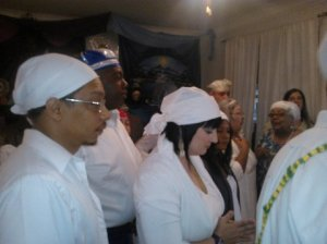 A photo taken of me and fellow members of the Ifá house, Ilē Ayó (The House of Joy), at a bembe for the orisha Oyá. October, 2012