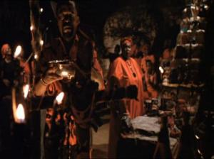 "Members of the nefarious secret society depicted in the film ""The Serpent and the Rainbow,"" which are visually differentiated from other Vodou practitioners in the film by their trademark red and black ritual apparel."