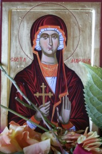 The icon of Ognjena Marija adorned with flowers in the Bosnian Serb enclave of Republika Srpska.
