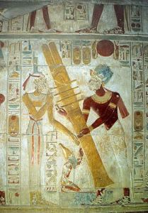 Raising of the djed pillar: Isis (Her hair cut as a sign of mourning) is assisted by the Pharaoh Seti I (on the right). Painting from the tomb of Seti I, Abydos.