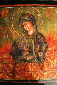 Russian Orthodox icon of Ognjena Marija, showing Her surrounded by archaic solar symbols.
