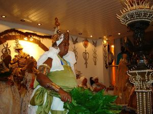 An iyalorisha, or initiated priestess, of the Orixa Osanyin in the African Diaspora Religion of Candomble in Brazil. There are more worshipers of the Orisha in the New World than the Old World of the West African nations (chiefly Nigeria) where these faith traditions originated!