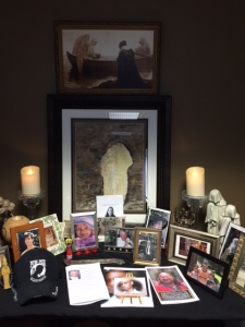 A photo of my brother (left, tall wooden frame behind the POW-MIA cap) and beaded Osiris statue necklace were among my offerings for our group altar for the dead.