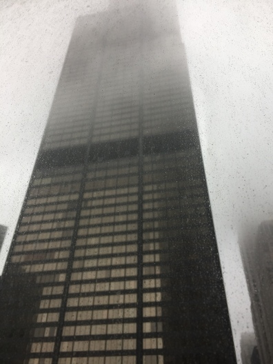 The Sears Tower is engulfed in fog, an apt expression of the Neptunian vibes afoot.