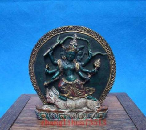 Tibetan clay statue of a Wrathful Deity slaying a demon.