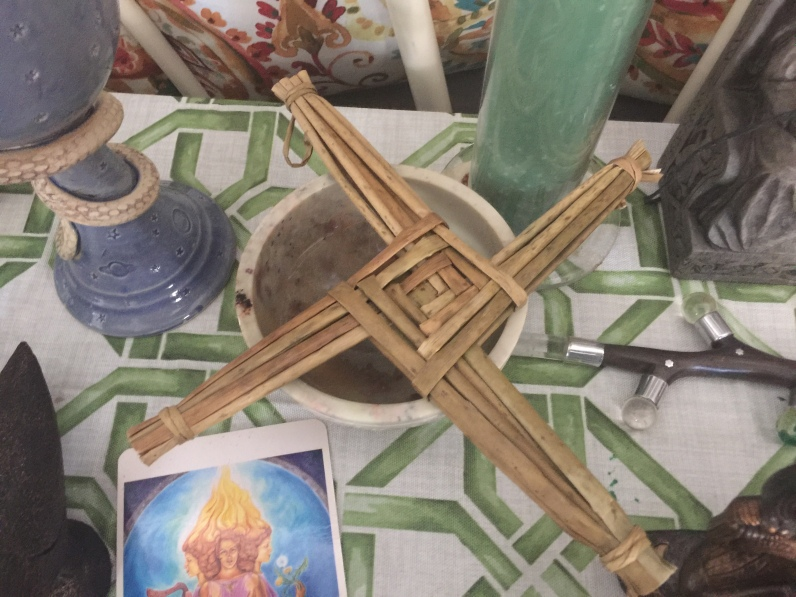 My Brigid's Cross is a few years old and was woven from local cat-tail grasses. It adorns my Imbolc altar. (c) A Urosevic 2021