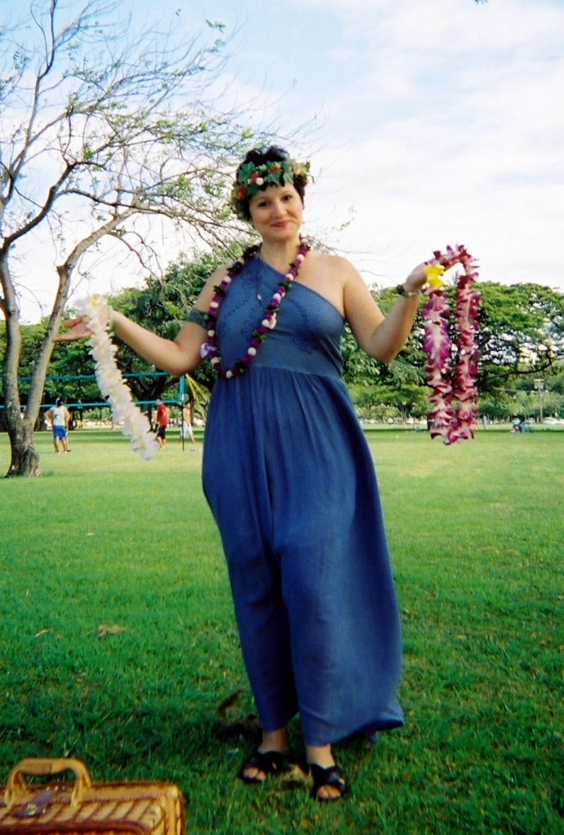 Here I am at the 2006 Honolulu Beltane ritual I co-facilitated with my friend, Kevin: I'm holding aloft his May King white lei and my May Queen plumeria lei.